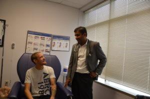 Dr Tindni advising patient
