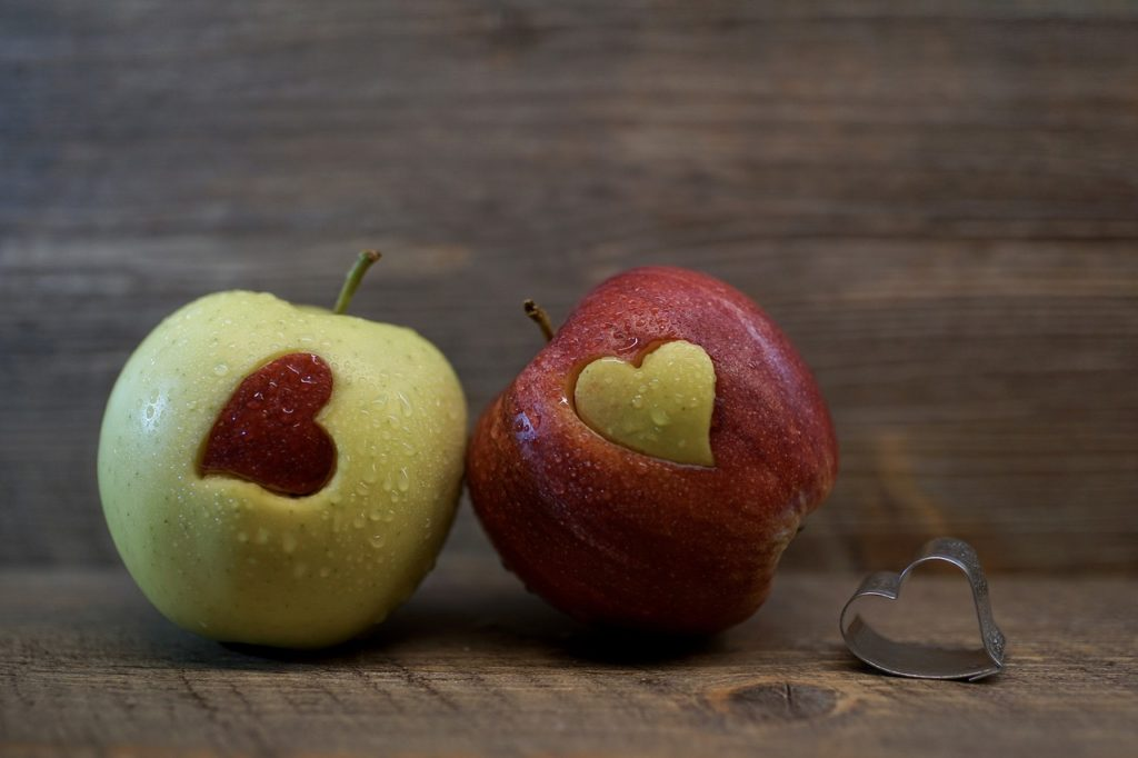 red-and-green-apples-with-cut-out-heart-shape-in-center