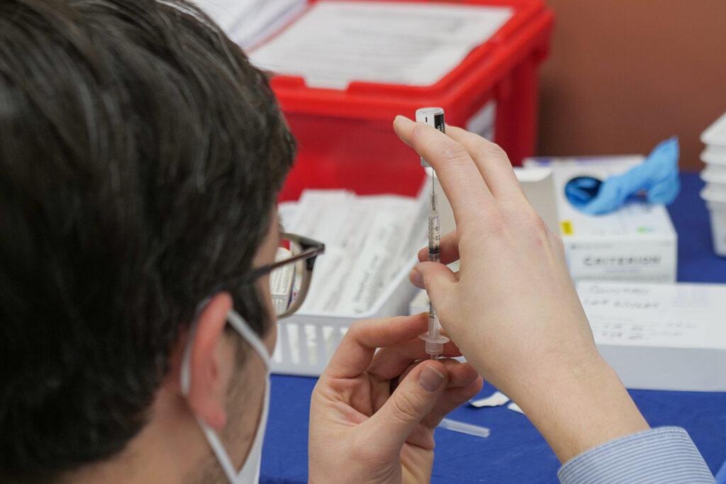 man-preparing-covid-19-vaccine