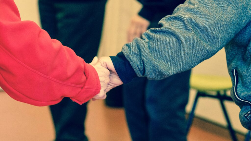 two-older-people-holding-hands